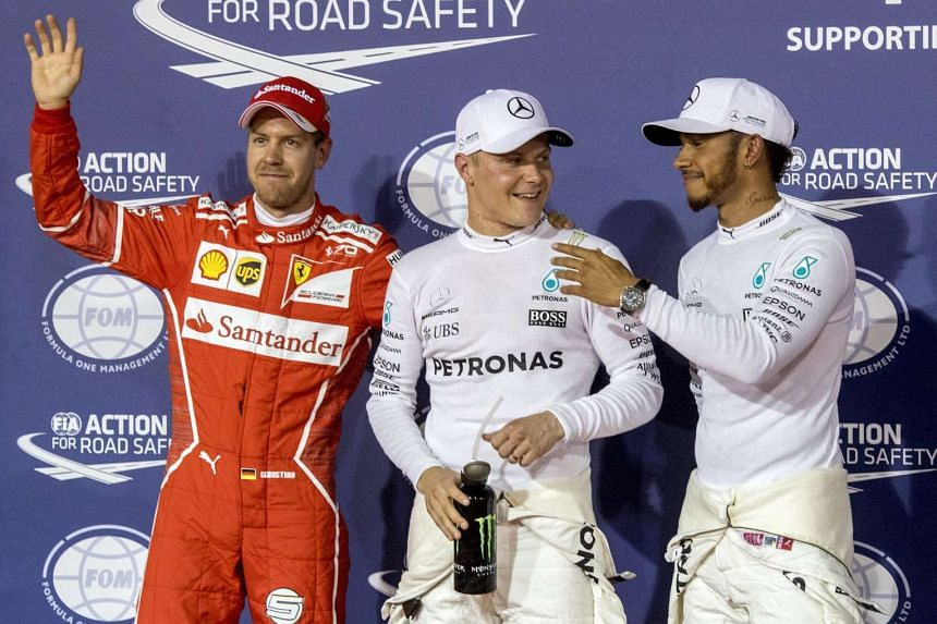 Valtteri Bottas (centre) after qualifying for pole, with Lewis Hamilton (right) and Sebastian Vettel.