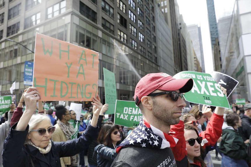 People march demanding US President Donald Trump release his tax returns, in New York, April 15, 2017.
