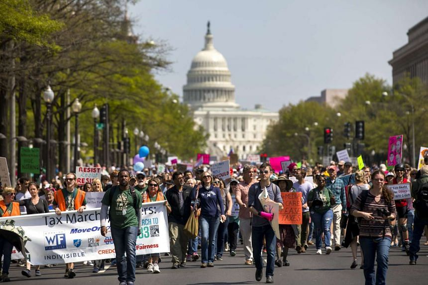 Thousands of protestors march down Pennsylvania Avenue to call on President Donald J. Trump to release his tax returns in Washington.