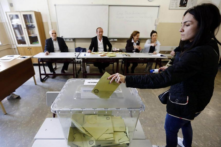 A young woman casts her vote at a polling station for a referendum on the constitutional reform in Istanbul, Turkey, on April 16, 2017.
