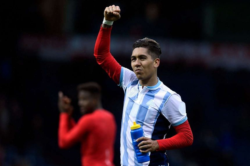 Liverpool's Roberto Firmino celebrates his team's win against West Bromwich Albion.