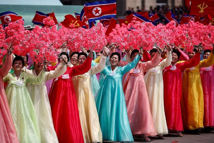 North Korea pulled out all the stops at the parade, and single-engine propeller- powered planes flew in formation over the crowds. Unlike at some previous parades attended by Mr Kim, there did not appear to be a senior Chinese official in attendance