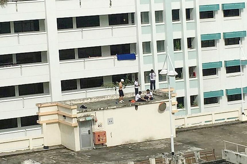 The five students were spotted taking selfies and dancing on the rooftop of the five-storey carpark in Hougang last Wednesday.