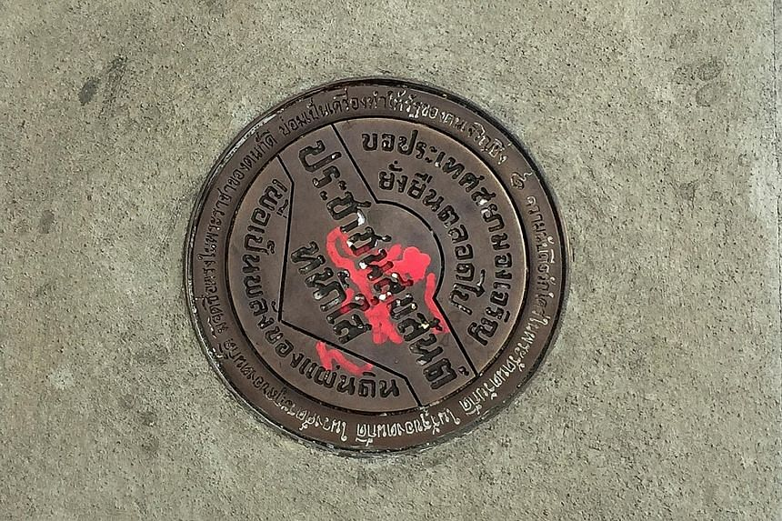 The new plaque seen in place of the missing one in Bangkok yesterday.