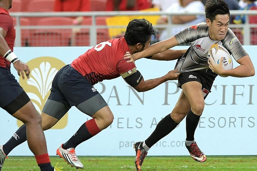 Mattias Chia of Singapore brushing aside his Malaysian opponent to score a try in a 19-7 win to clinch the host nation's first SEA sevens trophy. The triumph will put them in good stead ahead of August's SEA Games in Kuala Lumpur, where they will be