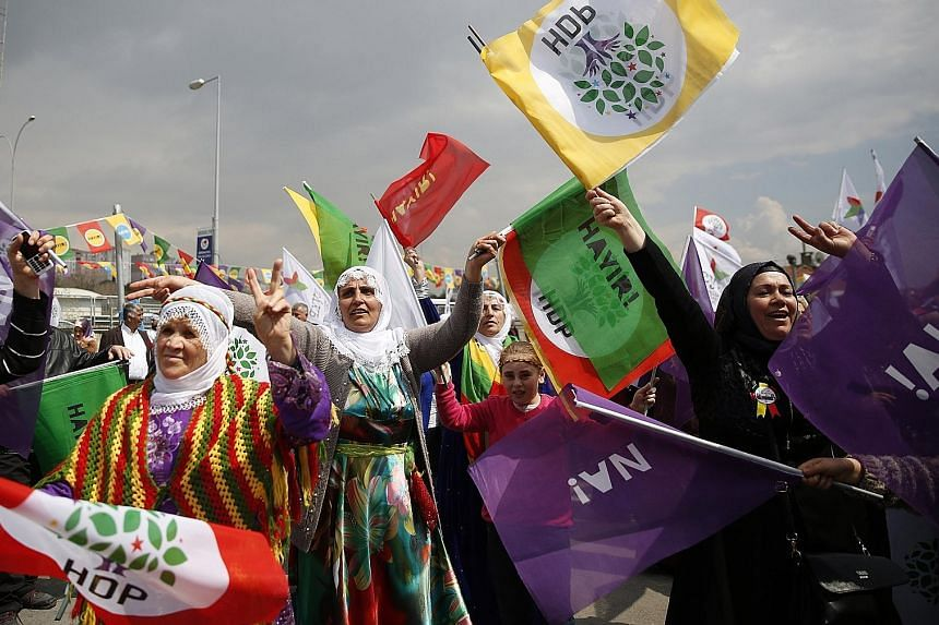 """Supporters of pro-Kurdish Peoples' Democratic Party shouting slogans and holding flags saying """"no"""" during a Vote No rally in Istanbul on April 8. A majority """"yes"""" vote in today's referendum on constitutional reform in Turkey will change the country's"""