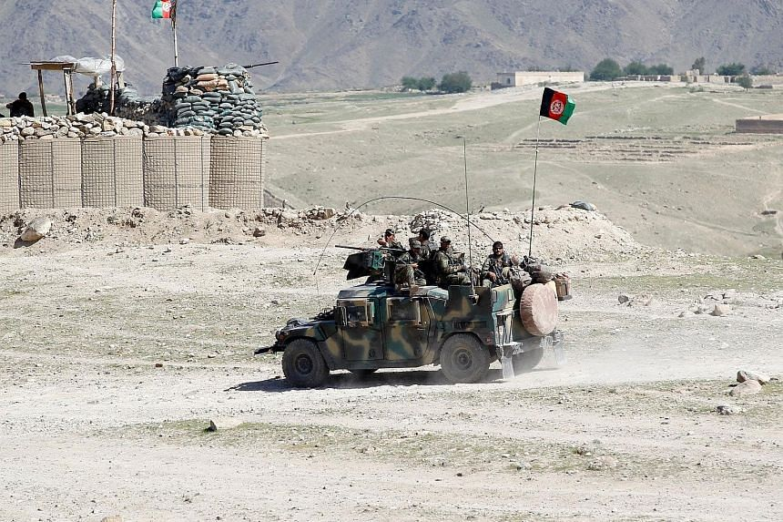 Afghan special forces on patrol in Pandola village on Friday, near the site where the US dropped a massive bomb in the Achin district of Nangarhar province in eastern Afghanistan. Still images from a video released by the US Defence Department shows