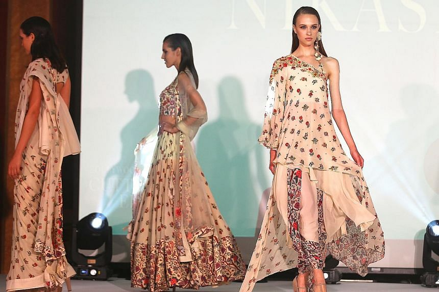 A singing politician and models strutting the stuff of India's foremost fashion designers shared the stage last night for a common cause. They were raising funds for the Singapore Indian Development Association (Sinda), as well as needy families in t