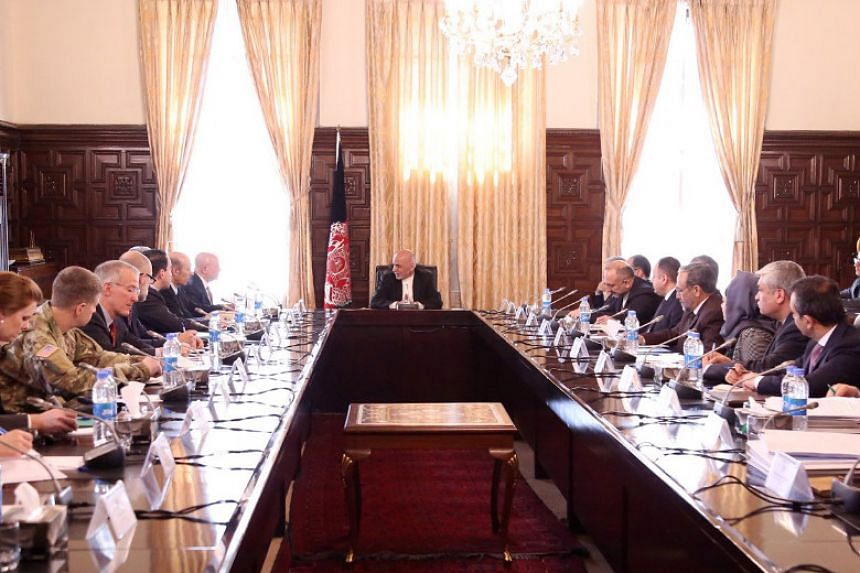 Afghan President Ashraf Ghani (centre) hosts a meeting with US National Security Advisor General H.R. McMaster in Kabul.