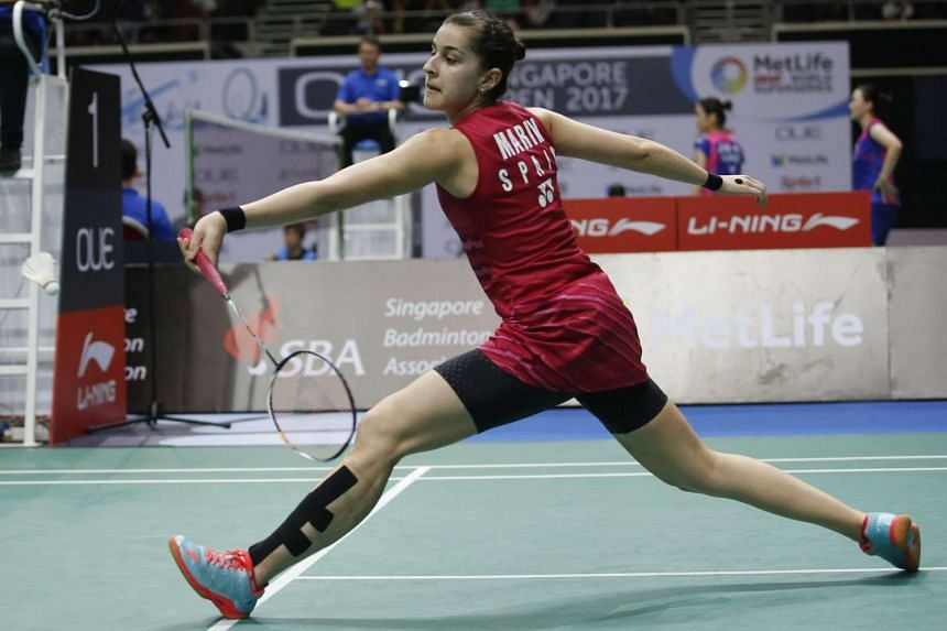 Carolina Marin of Spain in action against Sung Ji Hyun of South Korea during their semi-final women's singles match during the OUE Singapore Open Badminton Tournament at the Indoor Stadium in Singapore, on April 15, 2017.