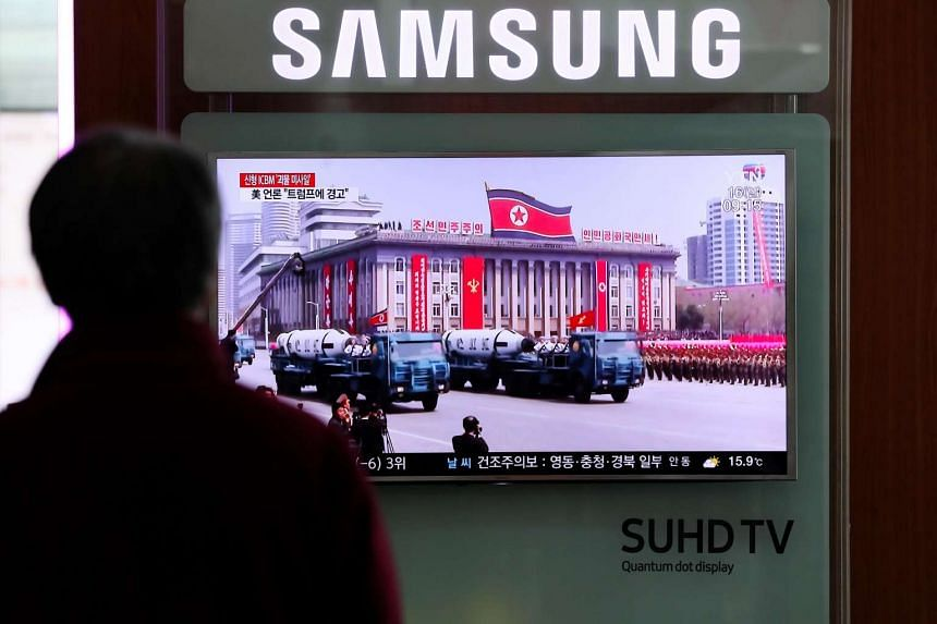A TV screen shows an image of unidentified missles displayed at a military parade during a news broadcast on North Korea's missile launch in Seoul on April 16, 2017.