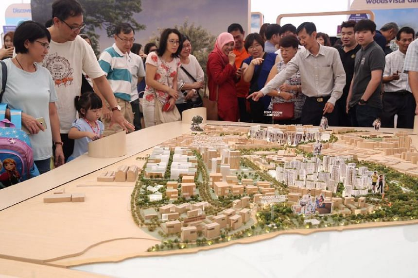 Woodlands residents viewing a model display of their future town at the launch of the Remaking Our Heartland exhibition in Woodlands, on Sunday (April 16).