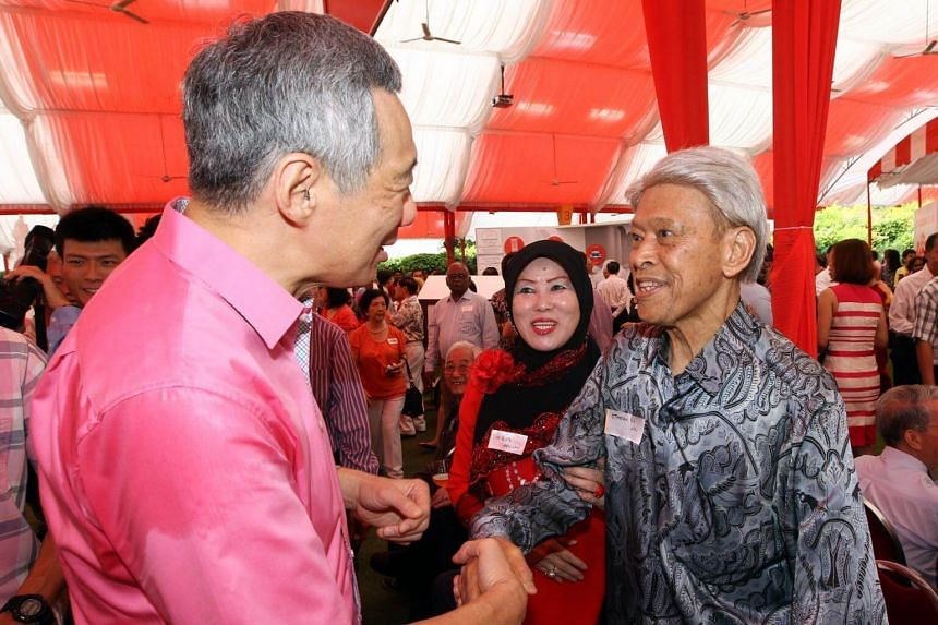 Prime Minister Lee Hsien Loong (left) shaking hands with former cabinet minister Othman Wok at the Pioneer Generation Tribute ceremony in 2014.