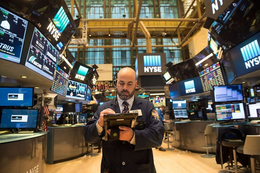 A trader at the New York Stock Exchange on March 31, 2017 in New York.  US stocks opened higher on April 17, 2017, helped by gains in technology and financial stocks.