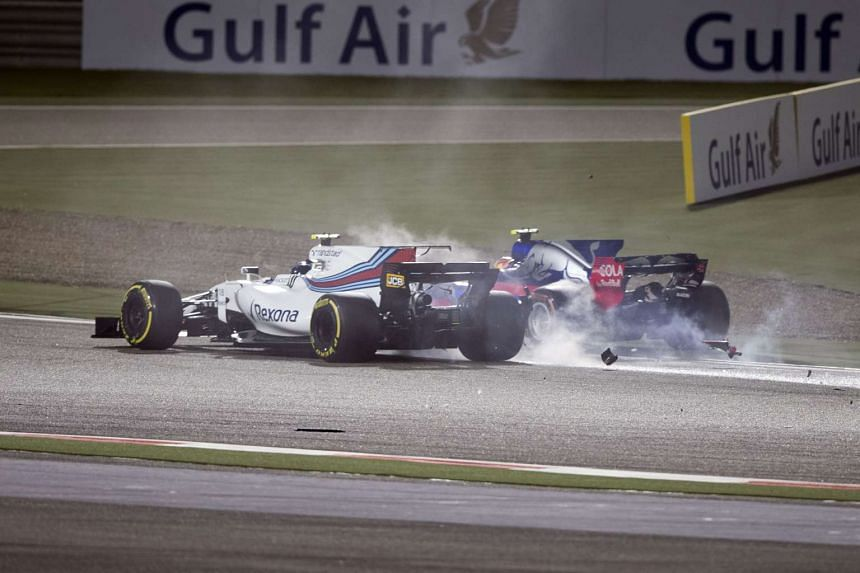 Williams driver Lance Stroll (left) and Scuderia Toro Rosso driver Carlos Sainz crashing during the Bahrain Grand Prix on April 16, 2017.