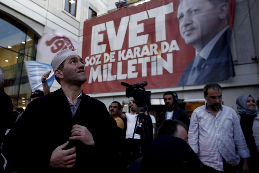 Residents react outside of the AKP party headquarters to the outcome of the referendum in Istanbul, Turkey, on April 16, 2017.