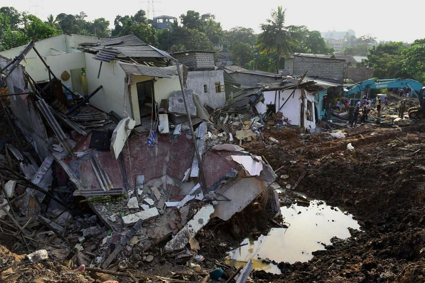Sri Lankan military personnel searching for possible survivors at the site of the collapsed garbage dump in Colombo, on April 16, 2017.