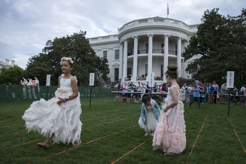 Children participate in the egg roll during the White House Easter Egg Roll on the South Lawn of the White House in Washington, DC,US, on April 17, 2017.