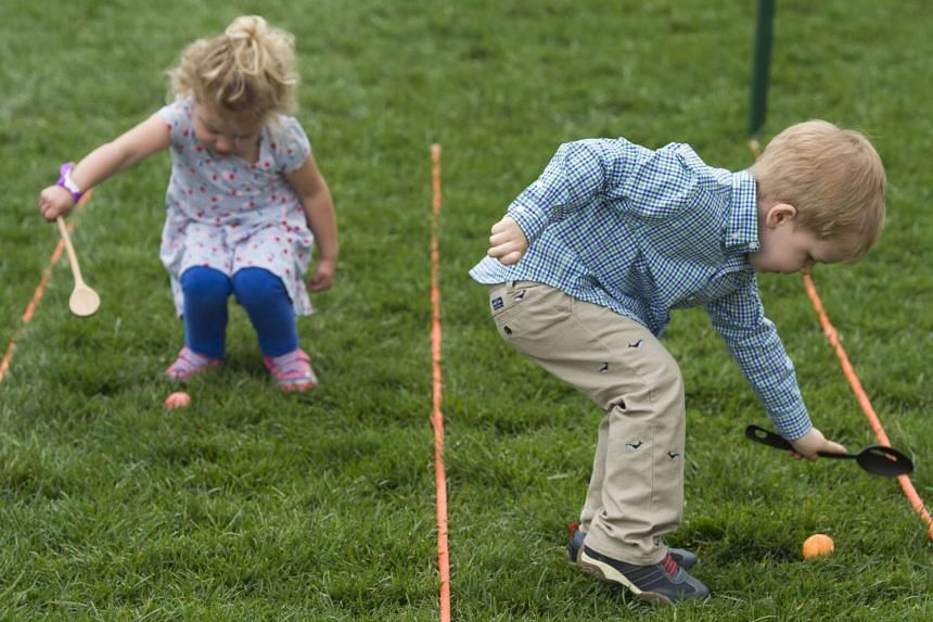 Children participate in an Easter egg roll race during the 139th White House Easter Egg Roll on the South Lawn of the White House in Washington, DC on April 17, 2017.