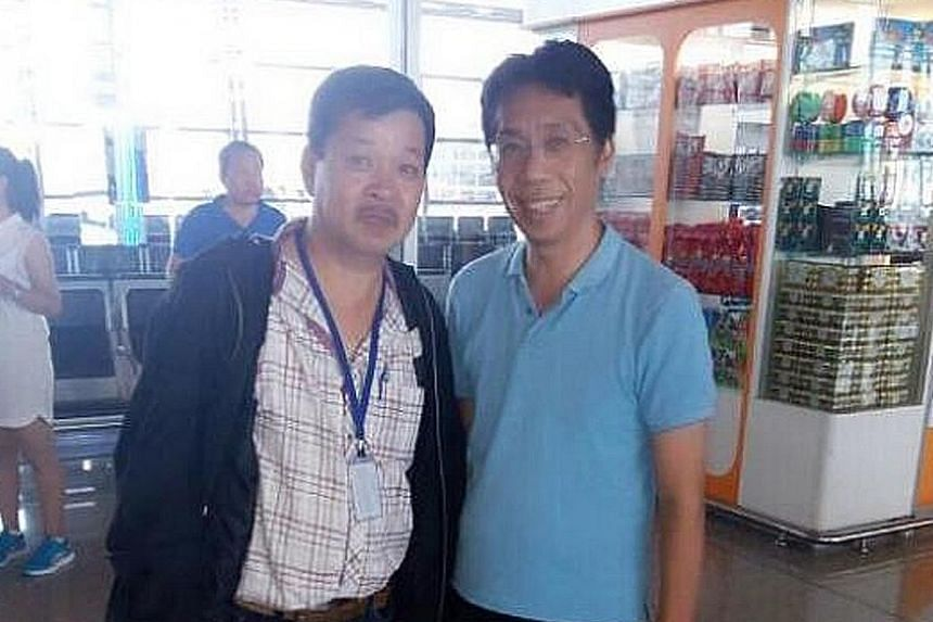 Mr Peter Chong (right) at Kuala Lumpur airport yesterday, after flying in from Thailand.