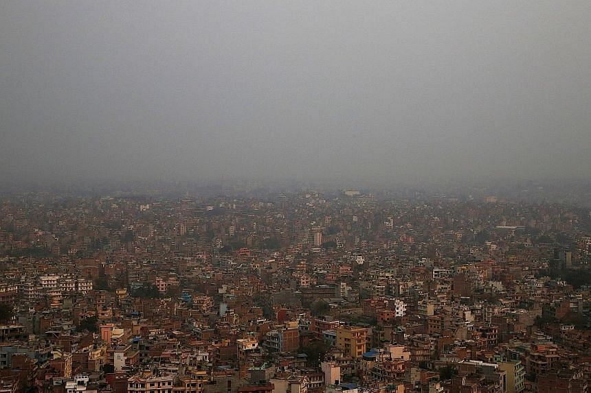 Kathmandu Valley covered in smog in February. Pollution in the city regularly reaches unhealthy levels, but proposals to tackle the problem by modernising the inefficient bus network have been stalled by transport syndicates that reportedly have infl