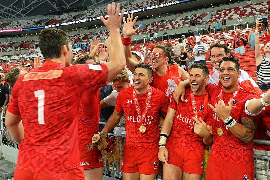 Left: Canada's Lucas Hammond evades the American defence to score the winning try in the Cup final of the HSBC Singapore Rugby Sevens at the National Stadium. Below: Before this momentous win, the Canadians came closest in 2014, when they lost the Cu