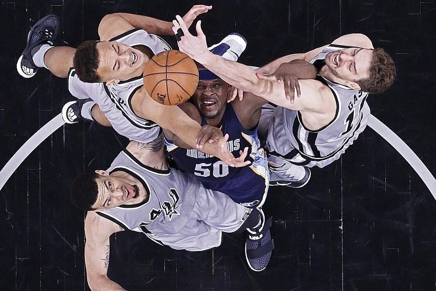 No way through for Memphis Grizzlies' Zach Randolph (centre), as he is surrounded by San Antonio Spurs' (clockwise from left) Kyle Anderson, Pau Gasol and Danny Green during their Game One clash in the NBA Western Conference play-offs. The Grizzlies