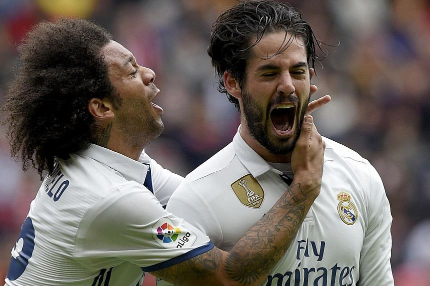 Brazilian Marcelo rushing to hug Isco after the Spaniard scored one of his two goals in Real's 3-2 win. He started only because the big names were rested for the Champions League.