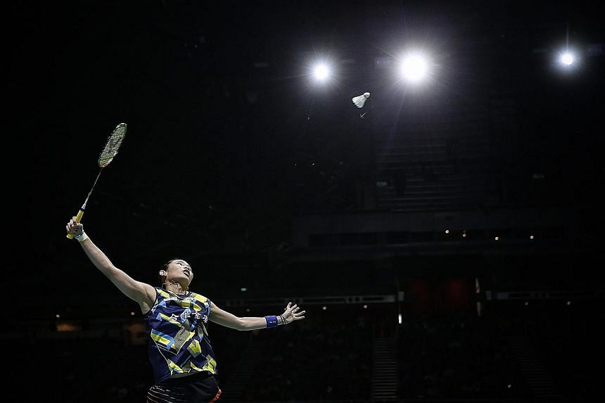 Chinese Taipei's Tai Tzu-ying on her way to beating Carolina Marin of Spain 21-15, 21-15 in the women's singles final to win the OUE Singapore Open. Tai's fifth title on the spin makes her the first woman to do so.