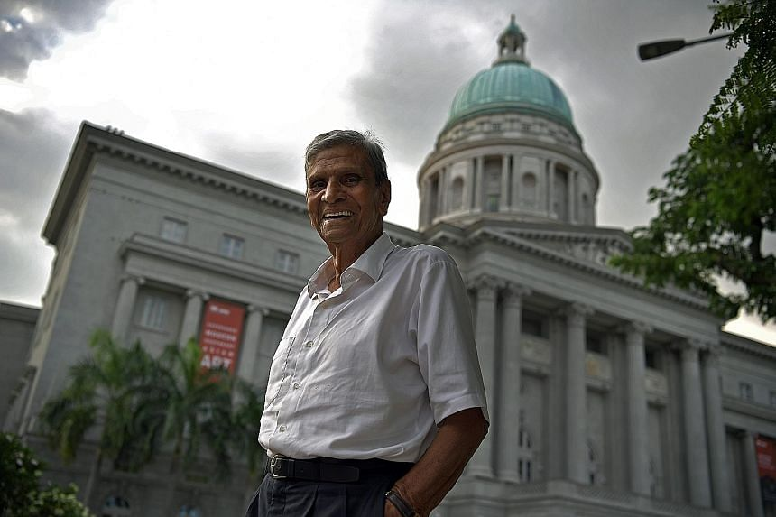 Singapore's oldest practising lawyer, Mr P. Suppiah, in front of the former Supreme Court building. His love of all sports has helped keep him fit and healthy over the years. Once a force in the football arena, he has now turned to golf for a workout