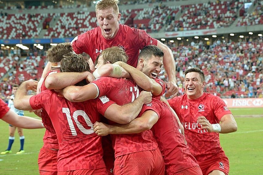 Canada players celebrating after they emerged as surprise winners of the HSBC Singapore Rugby Sevens yesterday by beating the United States 26-19 in the final at the National Stadium. Tournament favourites South Africa, Fiji and New Zealand all lost