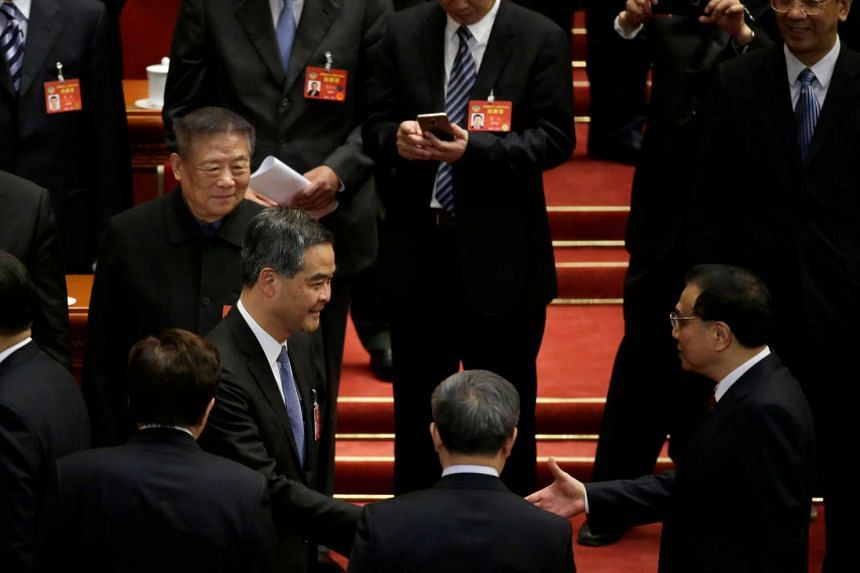 China's Premier Li Keqiang shaking hands with Hong Kong Chief Executive, vice-chairman of the National Committee of Chinese People's Political Consultative Conference (CPPCC), Leung Chun-ying, at the closing session of the CPPCC in Beijing, China, on