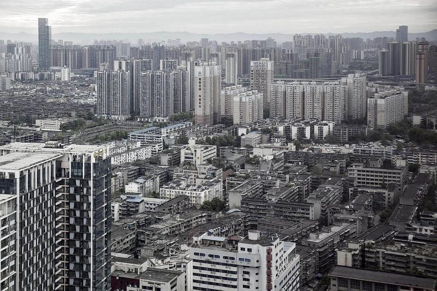 China's economy grew 6.9 per cent in the first quarter from a year earlier, supported by a government infrastructure spending spree and a frenzied housing market.
