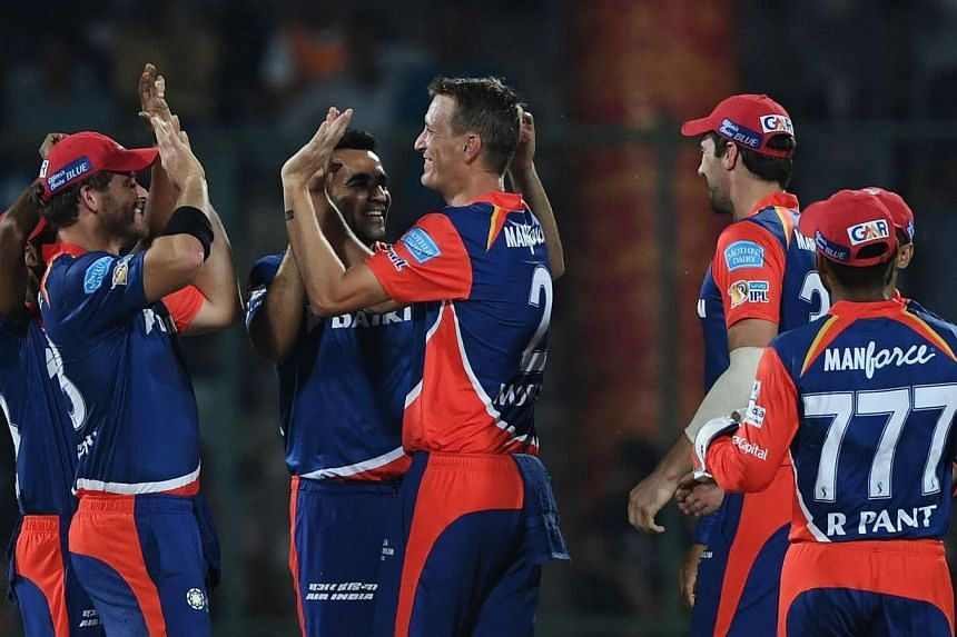 Delhi Daredevils cricketer Chris Morris (centre) celebrates the wicket of Kings XI Punjab cricketer Hashim Amla with teammates during the 2017 Indian Premier League (IPL) Twenty20 cricket match between Delhi Daredevils and Kings XI Punjab, on April 1