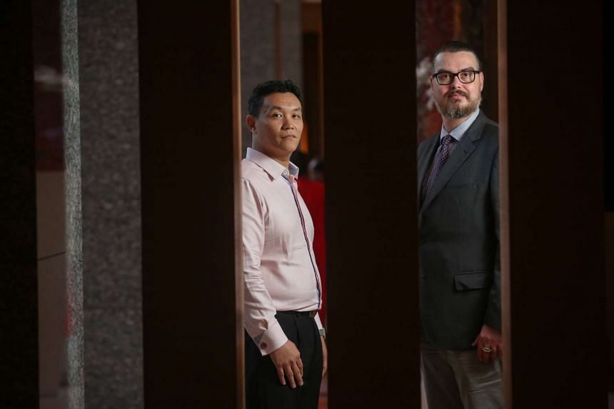 Besides calling for new laws, digital management consultant Ryan Lim (left) and Latvian academic Janis Berzins said commercial entities must cooperate with governments to clamp down on fake news.
