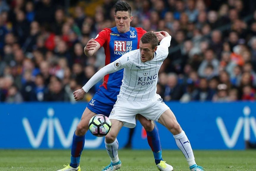 Leicester City's English striker Jamie Vardy (front) vying with Crystal Palace's English defender Martin Kelly during the English Premier League football match between Crystal Palace and Leicester City at Selhurst Park in London on April 15, 2017.