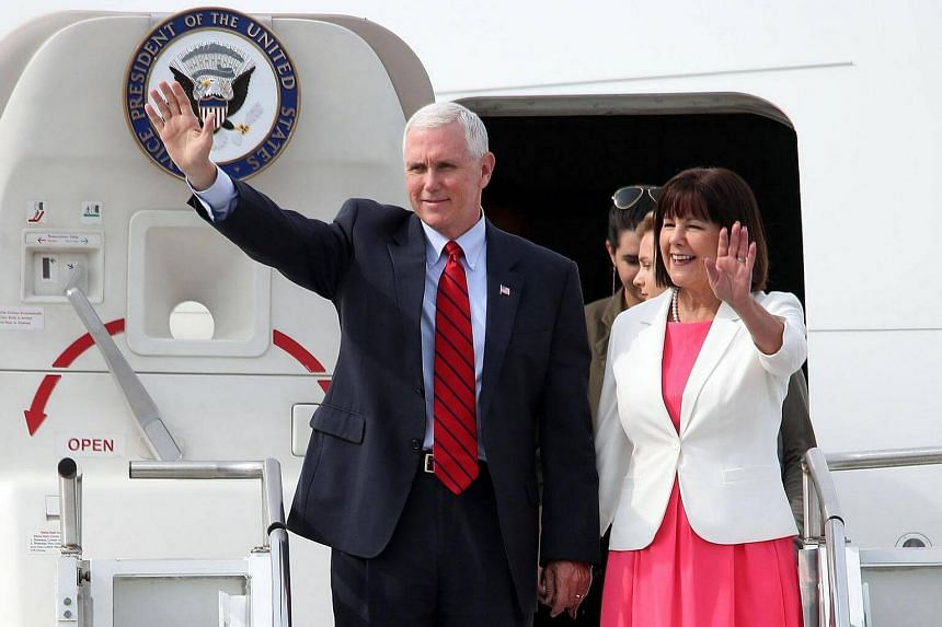 US Vice President Mike Pence and his wife Karen Pence waving as they arrive at the US Osan Air Base in Pyeongtaeck on Sunday (April 16).