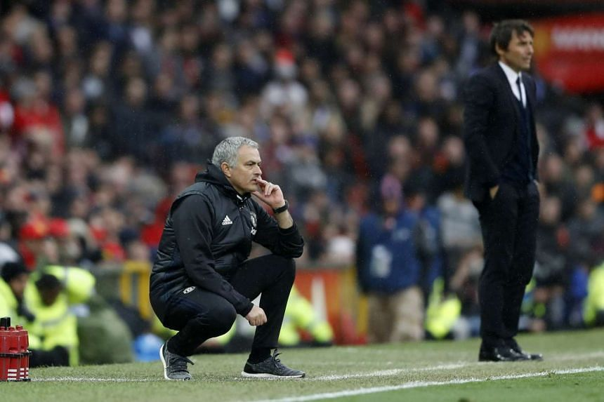 Manchester United manager Jose Mourinho and Chelsea manager Antonio Conte watch from the sidelines.