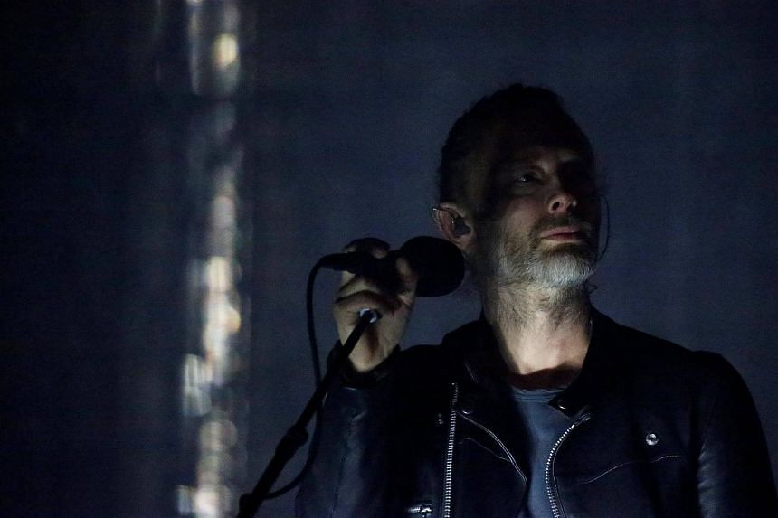 Lead singer of Radiohead Thom Yorke performs on the opening day of the Coachella Valley Music and Arts Festival in Indio, California on April 14, 2017.