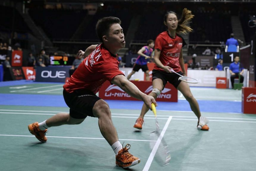 Singapore's Terry Hee and Tan Wei Han in action against China's Lu Kai and Huang Yaqiong during day 3 of OUE Singapore Open at the Singapore Indoor Stadium on Apr 13, 2017.