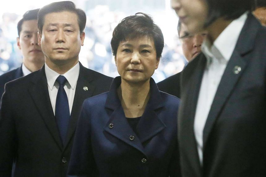 Ousted South Korean President Park Geun-hye arrives for questioning on her arrest warrant at the Seoul Central District Court in Seoul, South Korea on Thursday, March 30, 2017.