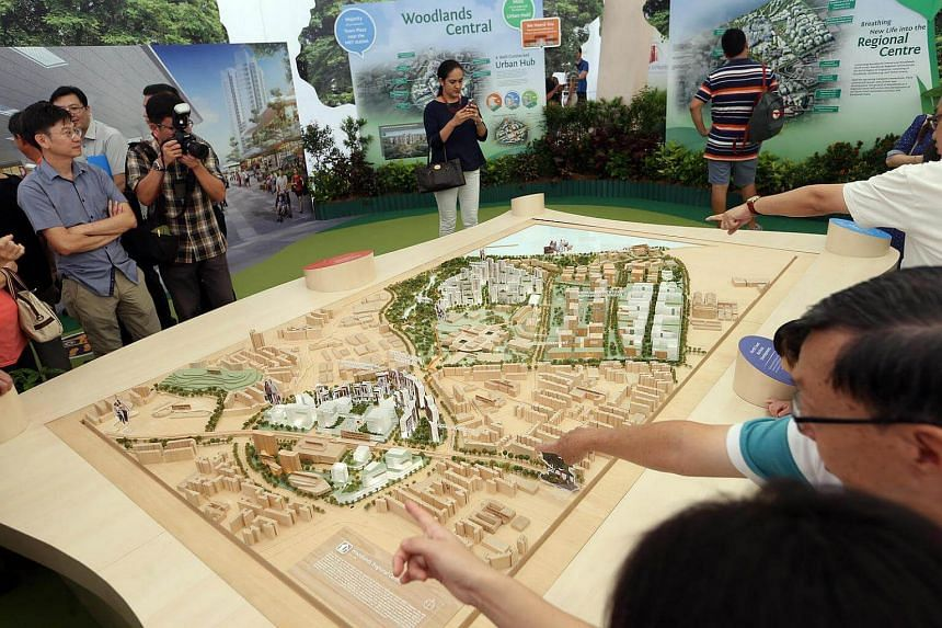 Woodlands residents viewing a model of their future town at the Launch of Remaking Our Heartland exhibition in Woodlands on Sunday (April 16).