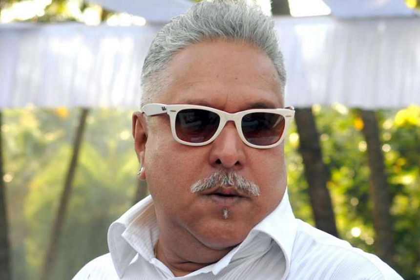 Vijay Mallya attends the launch of the Kingfisher 2014 calendar in Mumbai on Dec 21, 2013.