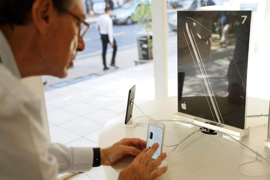 A customer views an Apple Inc. iPhone at a Maxim Store in Buenos Aires, Argentina, on April 7, 2017.