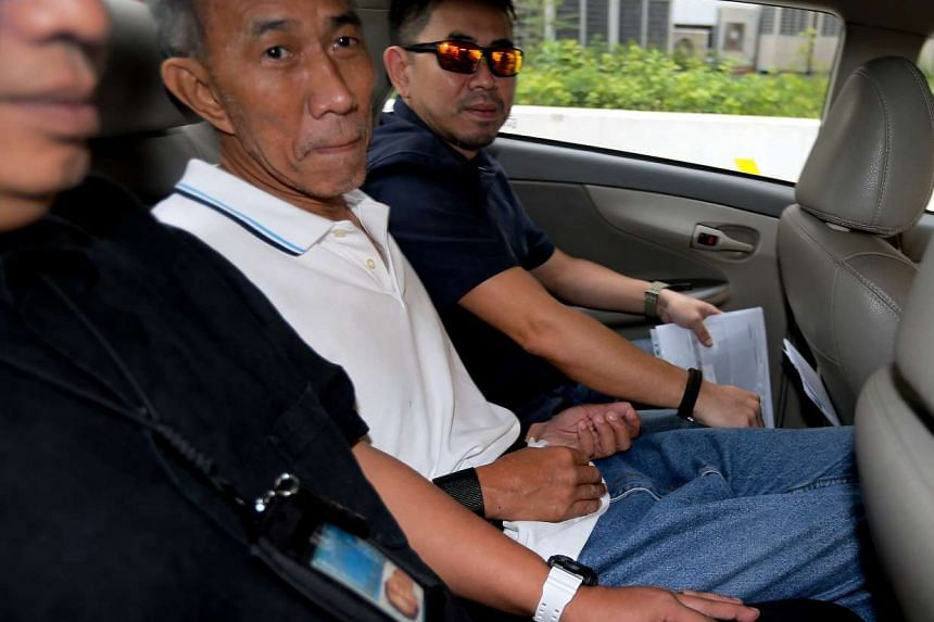 Yeo Liang Chai (centre) was charged in court with committing mischief by fire.