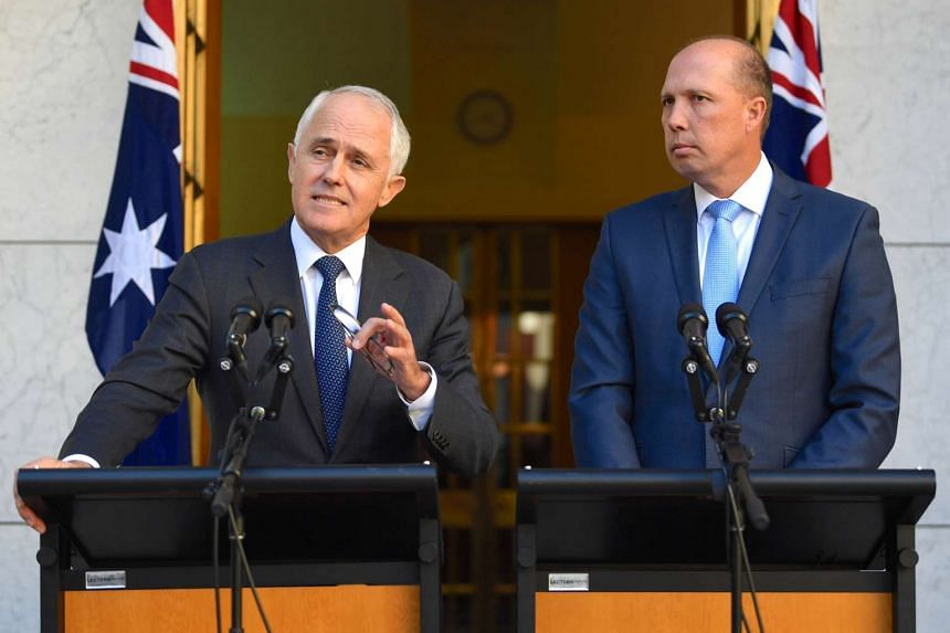 Australia's Prime Minister Malcolm Turnbull speaking as Immigration Minister Peter Dutton listens on during a media conference at Parliament House in Canberra, Australia, on April 18, 2017.