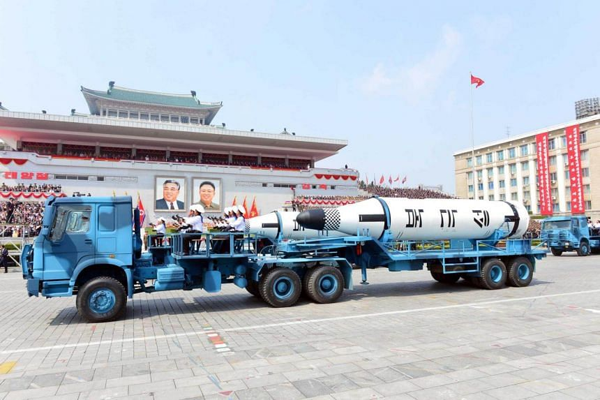 Military vehicles carry missiles during a military parade marking the 105th birth anniversary of country's founding father Kim Il Sung, in this undated photo, released by North Korea's Korean Central News Agency (KCNA), on April 16, 2017.