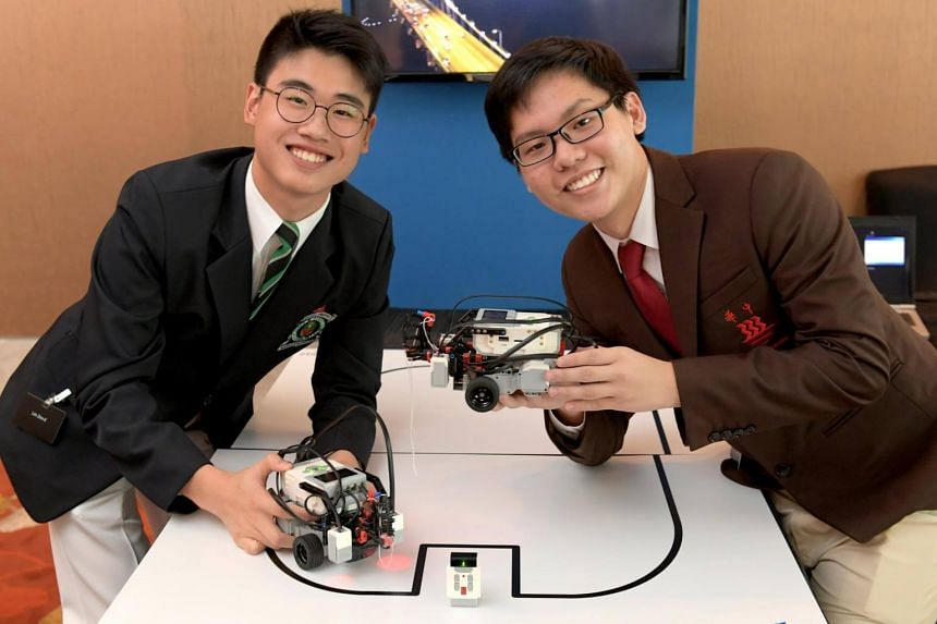 Lim Zinn-E (left), a year 4 student at Raffles Institution and Silas Yeo Shuen Yu, a year 5 student at Hwa Chong Institution with two LEGO Mindstorm Robots at the congress on April 18, 2017.