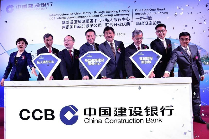 Minister for Education (Schools) and Second Transport Minister Ng Chee Meng (fourth from right) at the launch of three new units of China Construction Bank at Regis Hotel on April 18, 2017.