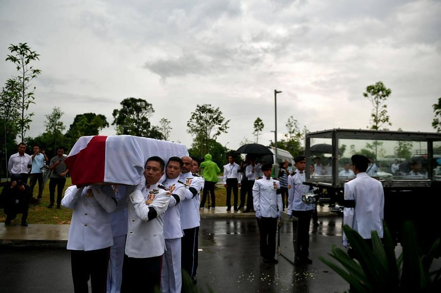Pallbearers carrying the casket of the late former minister Othman Wok, at Choa Chu Kang Muslim Cemetery on April 18, 2017.